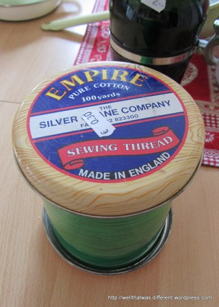 A cool British tin that looks like a spool of thread for my evolving sewing/crafting room.
