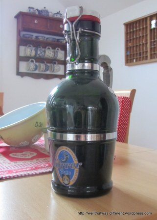 "A ""growler"" from an Austrian brewery. It weighs a ton--the handle is solid pewter. For the husband's collection of breweriana."