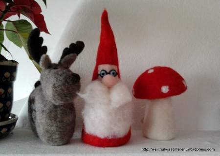 Very Austrian Santa made of felted wool.  Complete with a lucky mushroom.