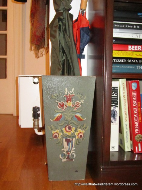 An umbrella stand!  Believe it or not, we really needed one.  This one is someone's craft project, I believe, but it's good and heavy with a metal pan in the bottom to catch drips,  and definitely vintage.  15 Euros.