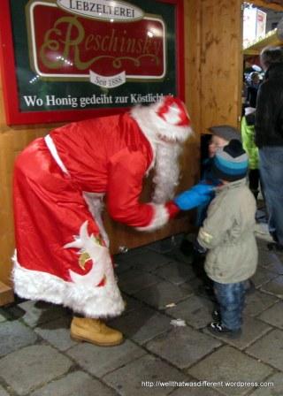 Nicola (not Santa!) meeting some kids at Am Hof.