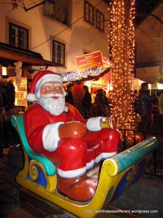 Santa looking askance (at the wild boar liver cheese?)