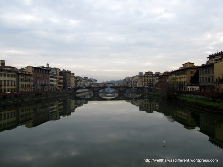 The Arno river with Ponte Vecchio in the background.