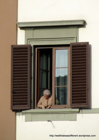 Everywhere in Europe, there are old ladies hanging out at windows people-watching. At the Piazza Vecchio (I think.)