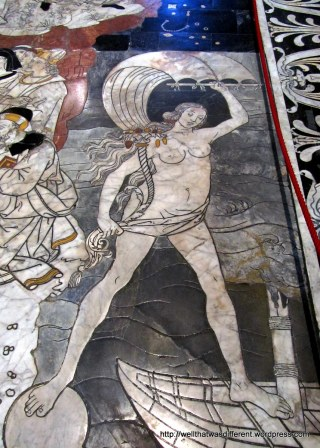 "The Duomo is known for its amazing floor ""cartoons"" or mosaics.  Here's an interesting detail of one--you'd have to hang from the ceiling to get a really good picture of the whole thing."