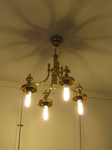 Hasta la vista tacky 70s brass chandelier that doesn't fit modern fluorescents.