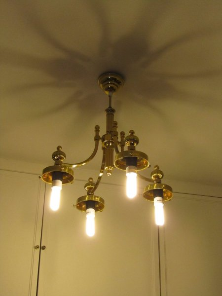 Hasta la vista tacky 70s brass chandelier that doesn't fit modern fluorescents.