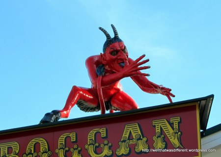 A hundred-year old toboggan ride with a medieval-looking devil on it.