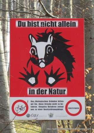 """You are not alone in Nature.""  I am not sure if this is meant to encourage environmental awareness or scare the heck out of hikers."
