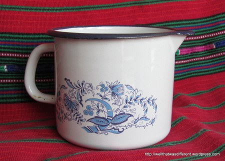 One of several blue and white enamel ware pitchers that I am using to organize stuff on the bathroom counter.
