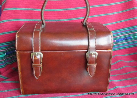 A vintage leather handbag I am using to store my embroidery supplies.