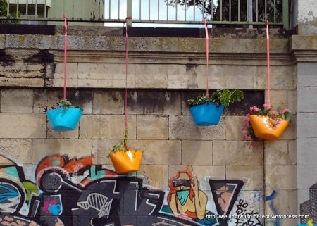 Funky planters at a canalside bar.
