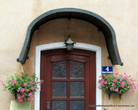 """The inscription over the door is very common in Central Europe. It can either stand for the initials of the Three Wise Men or """"Christus mansionem benedicat."""" (May Christ bless the house) depending on who you ask.  The numbers on either end refer to the date: this house was blessed in 2011."""