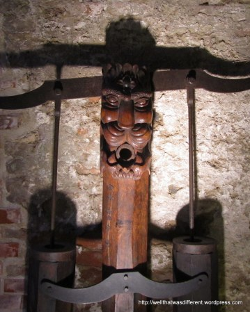 Some kind of wine press in the slightly spooky cellars.