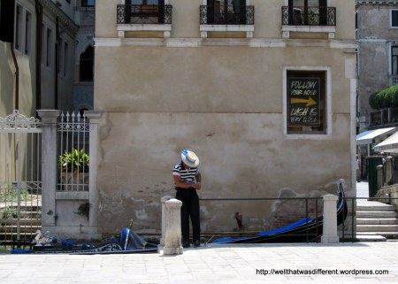 Gondolier taking a texting break.