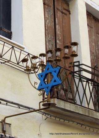 Sign for a shop selling Jewish religious items.