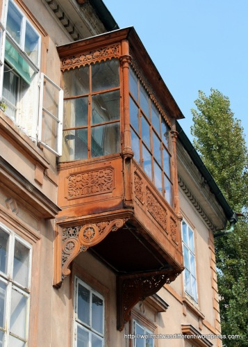 This iron balcony was in the Jewish quarter. I think it might be one of those windows that orthodox women used to view public events,