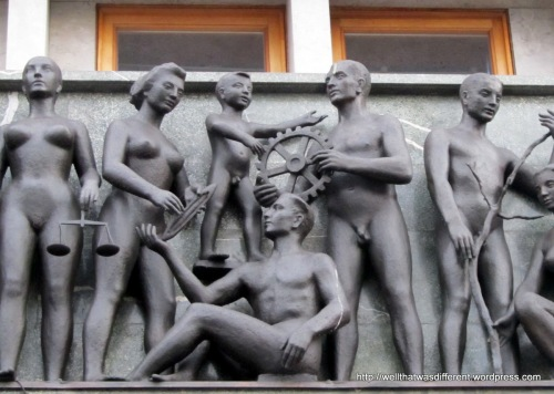 Close up of the happy naked (?) Communist workers.
