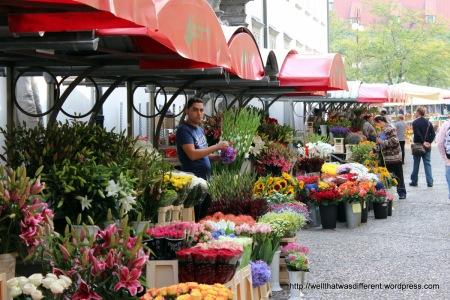 Flower market with a multicultural vendor.