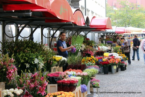 Flower market with a multicultural vendor.
