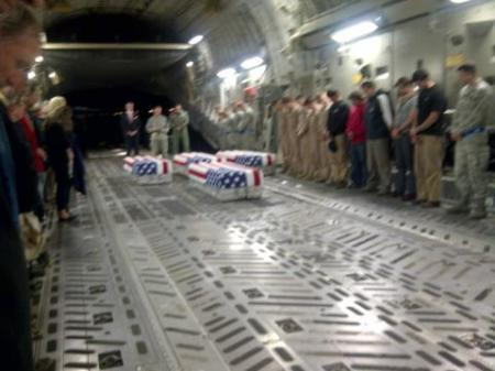 The coffins of Ambassador Chris Stevens, Information Management Officer Sean Smith, and security contractors Tyrone Wood and Glenn Doherty on their way home.