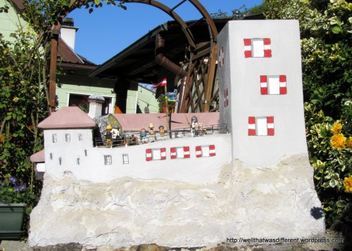 Another view of the Burg: this time as a lawn ornament with Lego people!