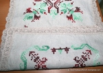 A hand-embroidered table runner.