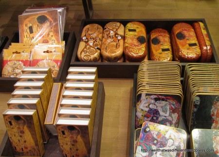 Klimt eyeglass cases, coasters, and matchboxes (?)