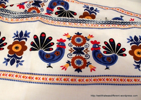 Great kitschy tablecloth. Really brightens up the kitchen!