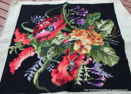 I like to rescue unfinished craft projects from thrift stores.  This is someone's crewelwork. I might make a pillow or a tote bag out of it.