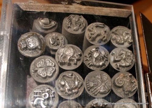 Metal dies used to stamp the little figures into molds from which the final product is made.