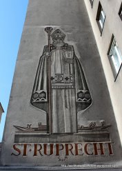Commemorative frieze on a modern apartment building next door