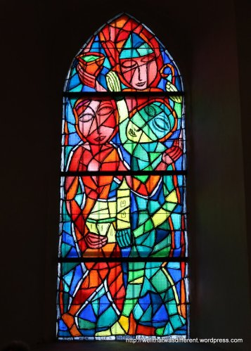 Modern stained glass window--these actually work pretty well with the austere interior