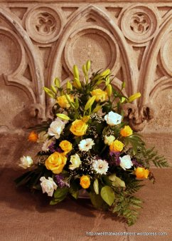 Flowers by the 16th century baptismal font