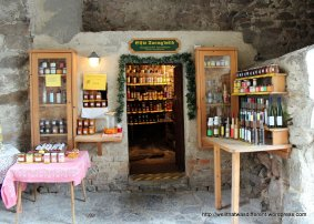 A tiny shop under the town gate