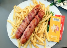 Lunch at the zoo. Bacon-wrapped, cheese-filled sausages. And don't forget the french fries.