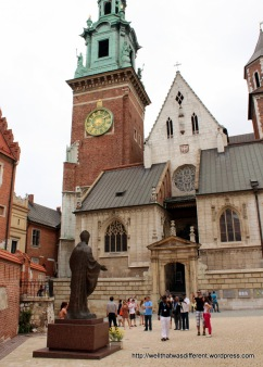 Statue of Pope John Paul in the cathedral courtyard. He was once a priest at this church.