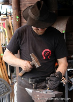 A blacksmith in action.