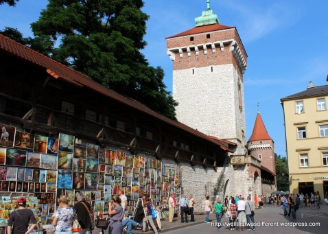 Bad art for sale on the city walls.
