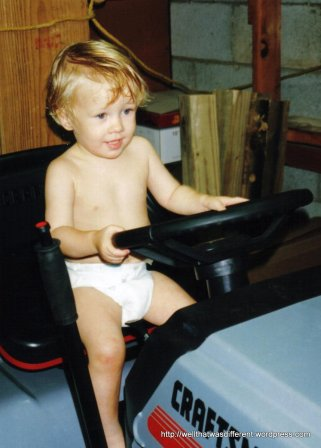 Driving his great-grandaddy's tractor.
