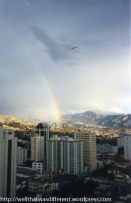 A rainbow out our kitchen window. Mount Ilimani (21,1000 feet) looms in the background.