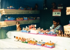 Selling good-luck miniatures at the Alacitas market.