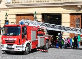 Kids getting a fire house tour at Am Hof.