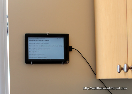 My cookbook, which is an old Nook reader mounted on the wall.
