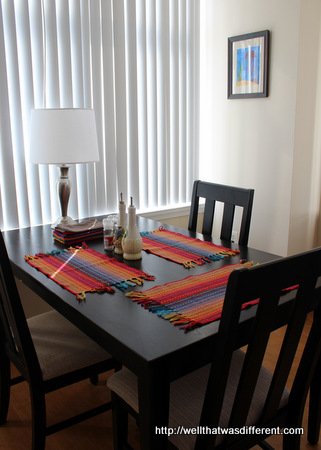 A little color for the dining table. (The brown plastic placemats that came with the apartment go under the cat food bowls!)