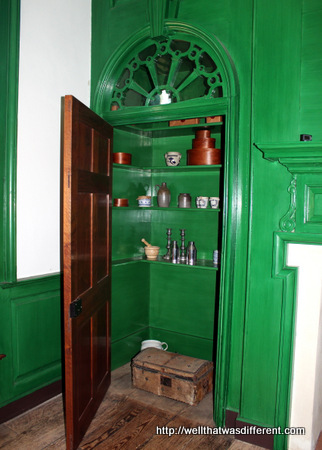 Pantry closets beside the fireplace.