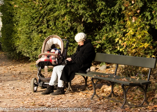 Babcia napping on a bench with her grandbaby.