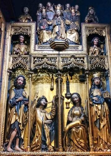 Elaborate carved wooden altarpiece.