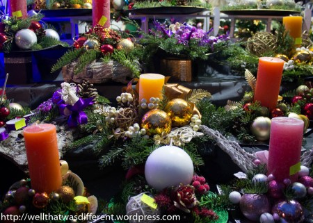 Lots of Christmas wreaths and candles.