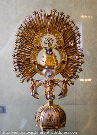 A collection of gifts received by the pope. This is a monstrance containing a relic.